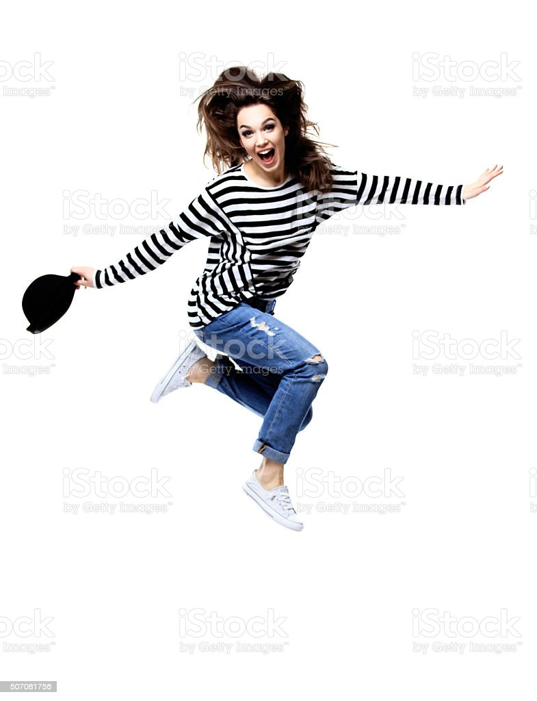 Beautiful jumping girl isolated on white stock photo