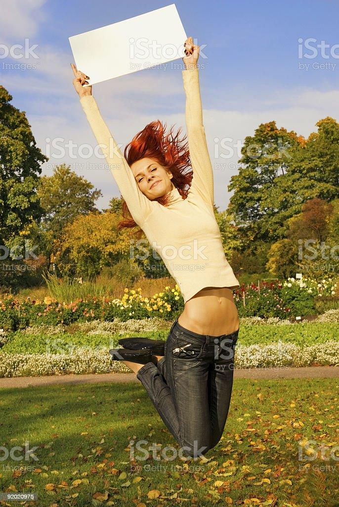 Beautiful jumping redhead girl royalty-free stock photo