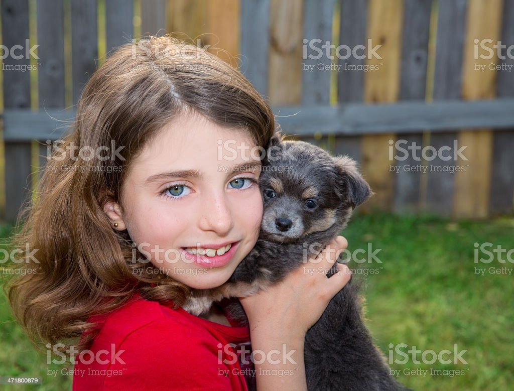 Beautiful kid girl portrait with puppy chihuahua doggy royalty-free stock photo
