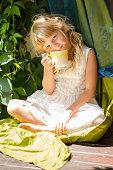 beautiful kid with mug of tea