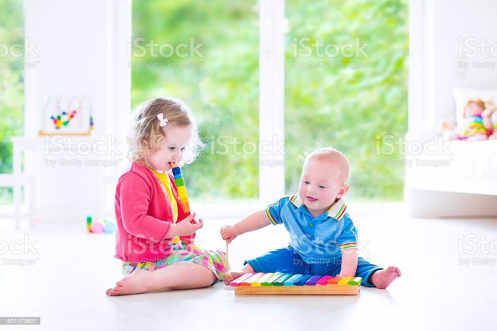 Beautiful kids playing music with xylophone stock photo