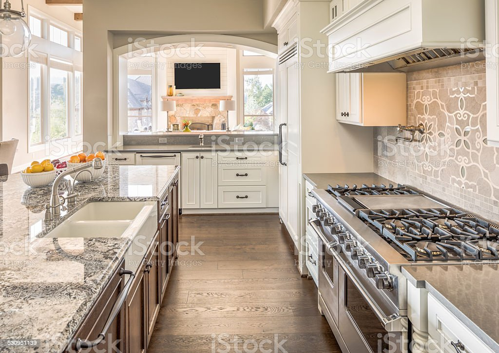 Beautiful Kitchen in Luxury Home. View of Living Room. stock photo