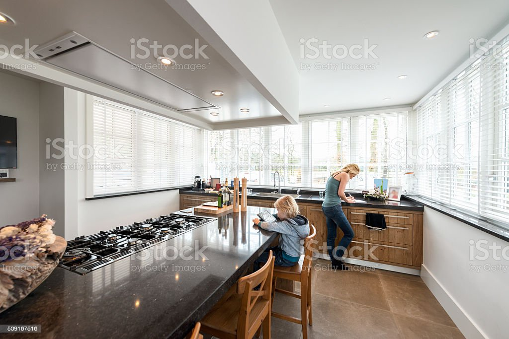 Beautiful Kitchen in Luxury Home with cooking Island stock photo