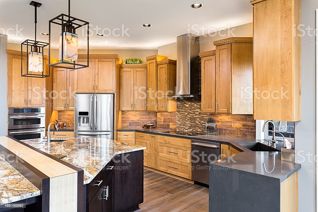 Beautiful Kitchen in Luxury Home with Island and Stainless Steel stock photo