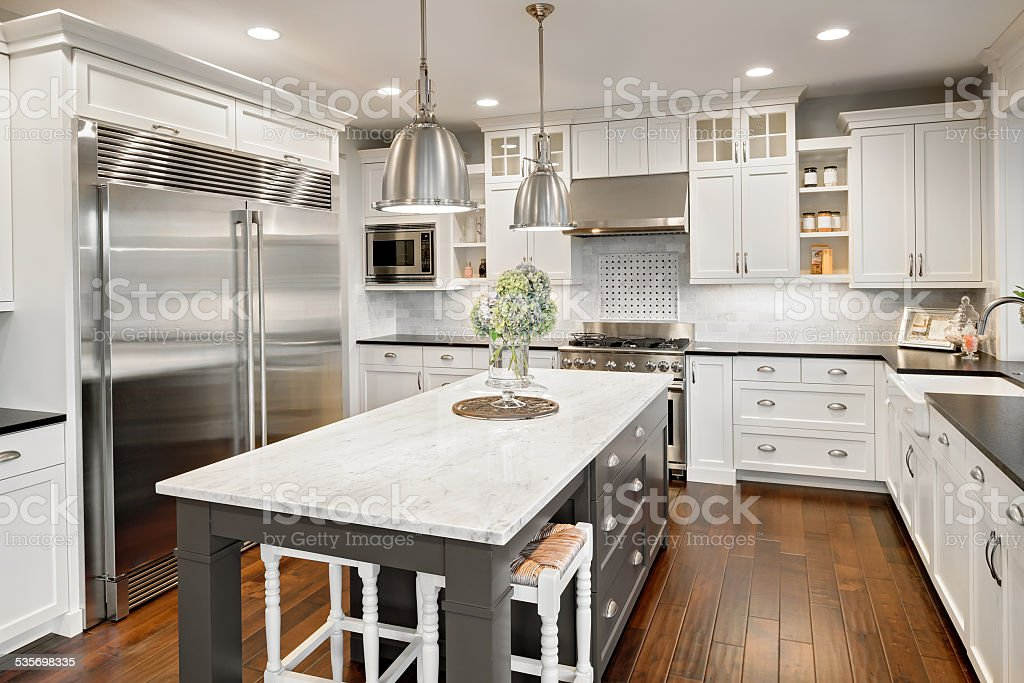 Beautiful Kitchen in Luxury Home with Island and Stainless Steel royalty-free stock photo