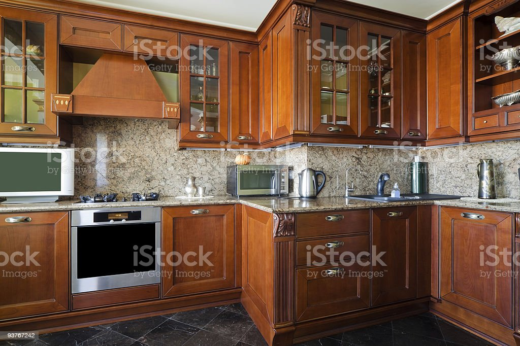 Beautiful kitchen with wooden cabinets and appliances stock photo