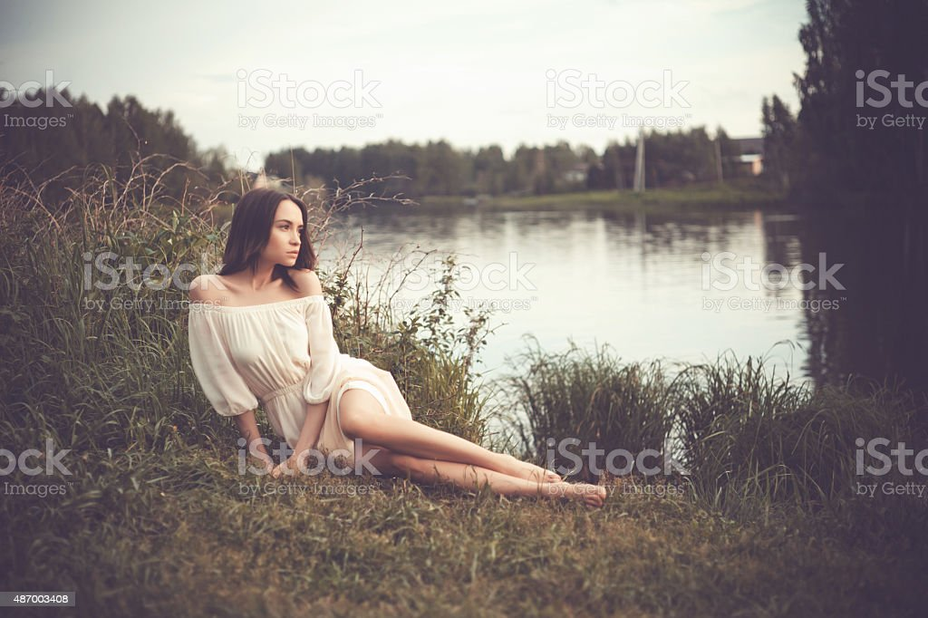 Beautiful lady at river stock photo