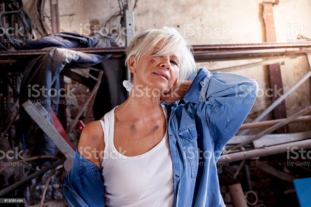 beautiful lady at work in his old workshop stock photo
