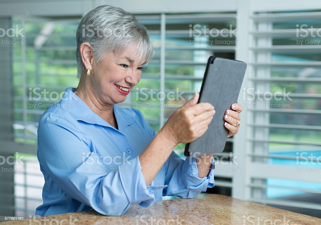 Beautiful lady checking her emails stock photo