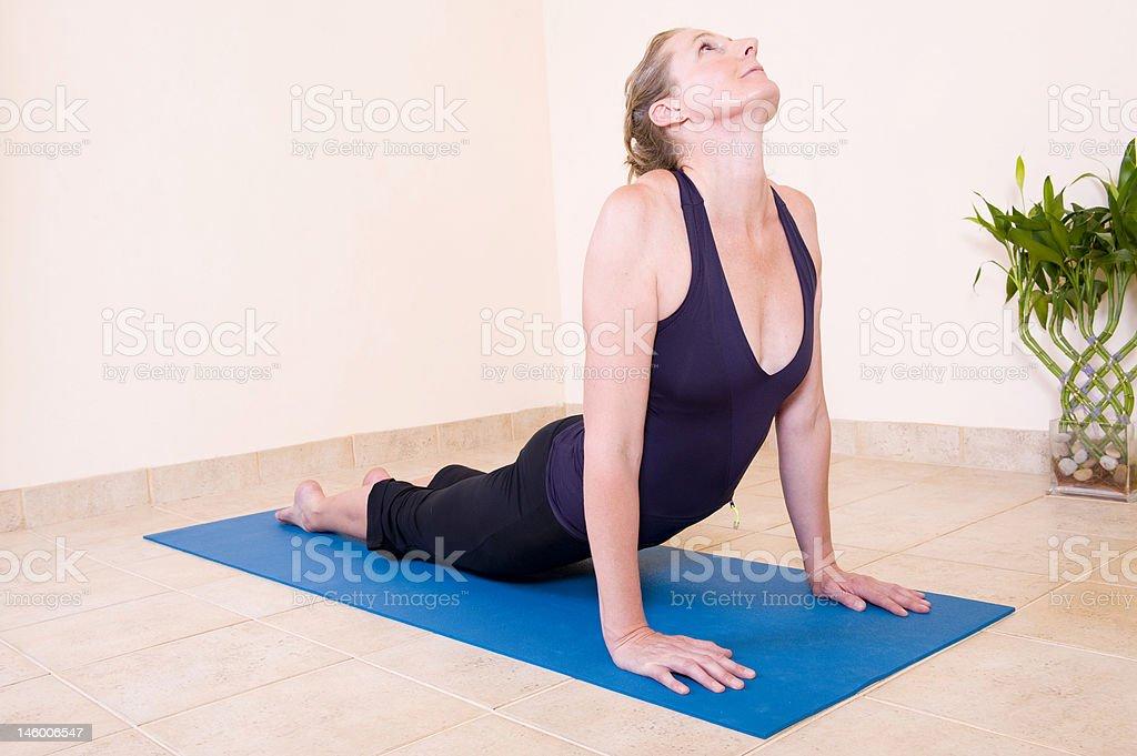 Beautiful lady doing yoga stock photo