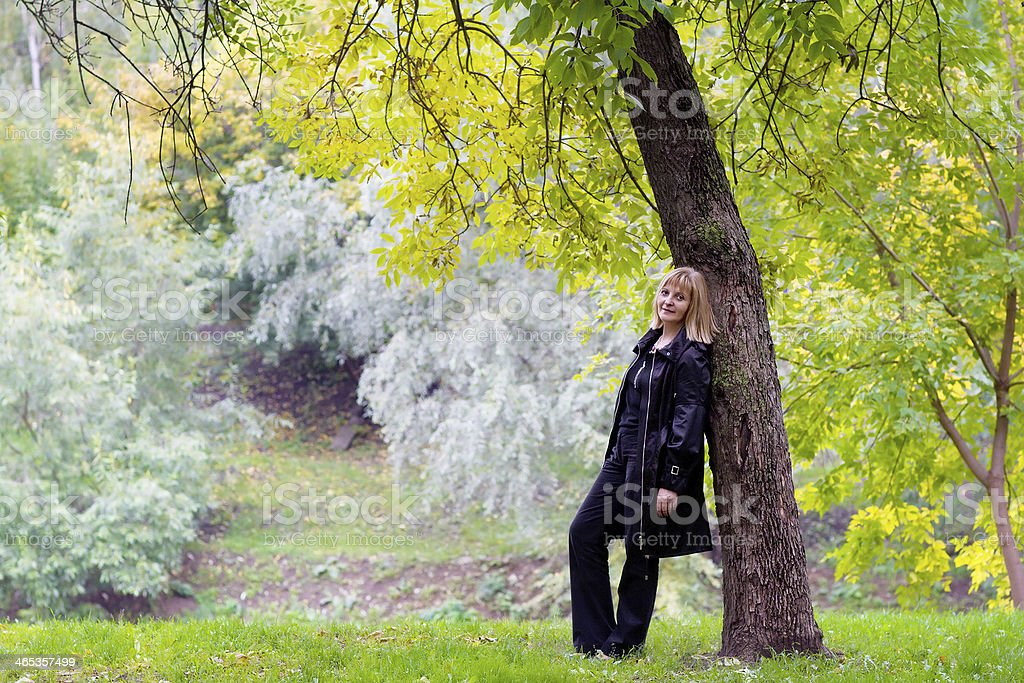 Beautiful lady in a colorful autumn park royalty-free stock photo
