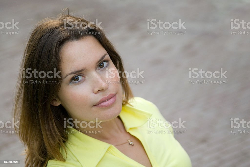 Beautiful lady in a yellow t-shirt royalty-free stock photo