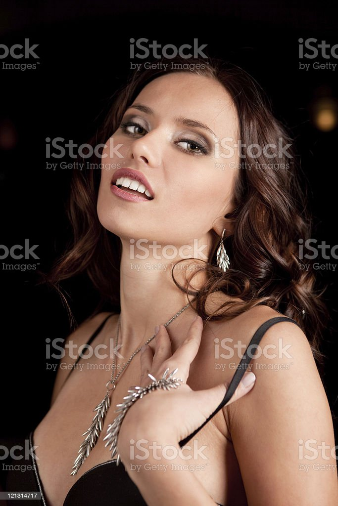 Beautiful lady in necklace on her neck. stock photo