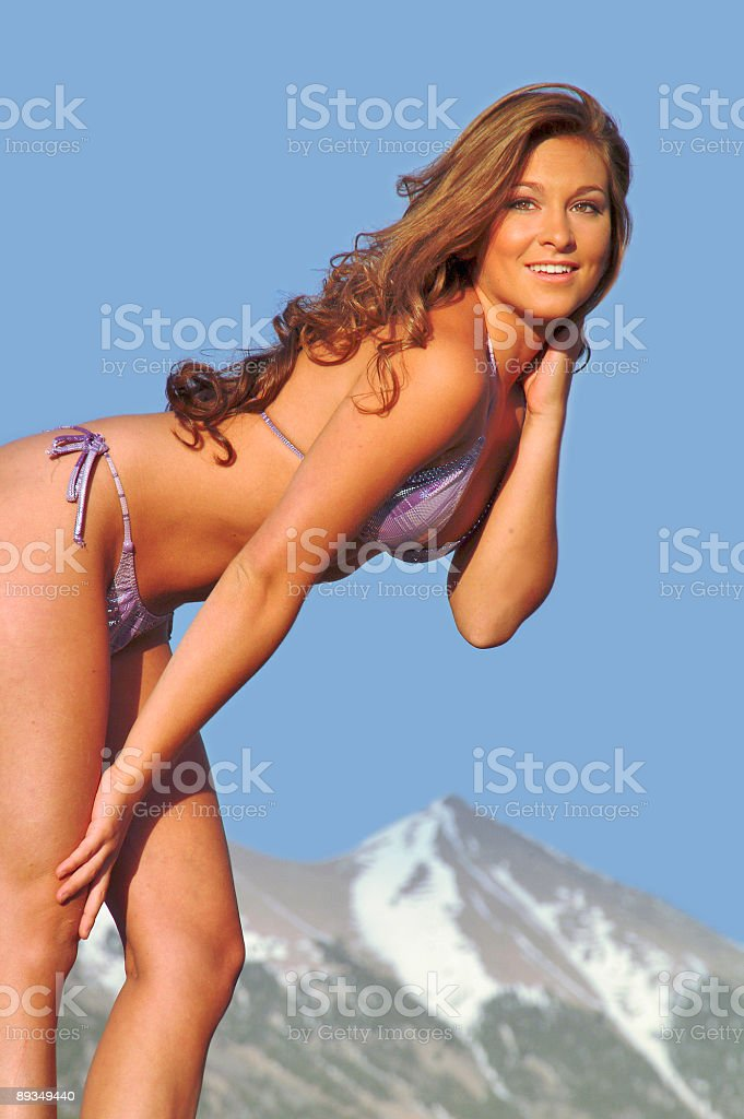 beautiful lady in swimsuit against blue sky stock photo