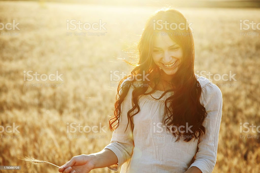 Beautiful lady in wheat field stock photo