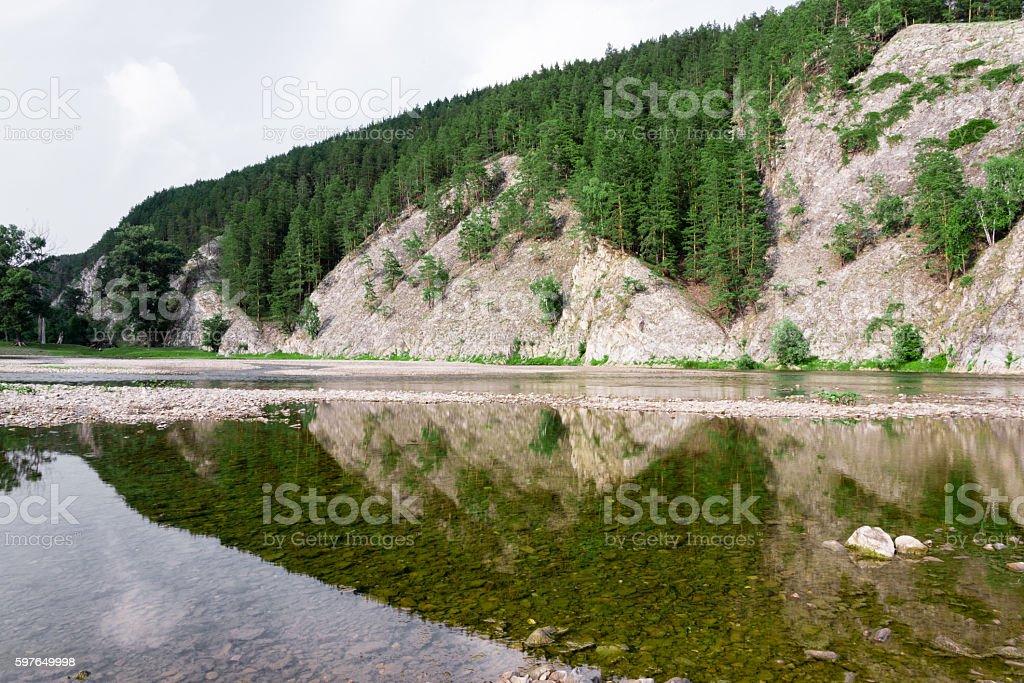 Beautiful Lady reflection of mountains stock photo
