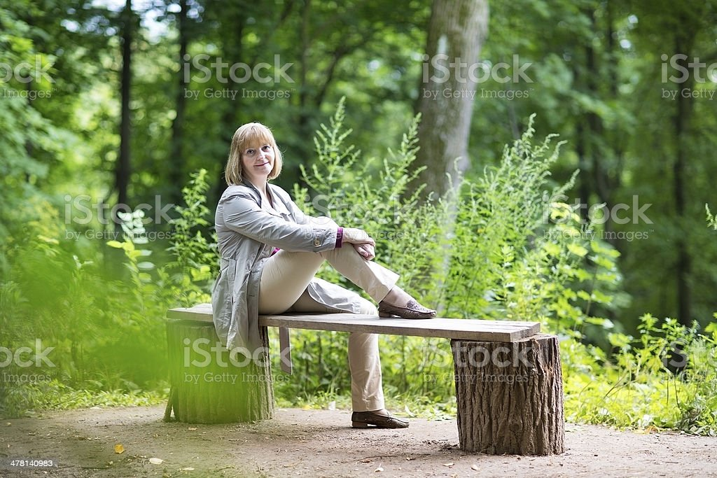 Beautiful lady relaxing in a park on a rainy day