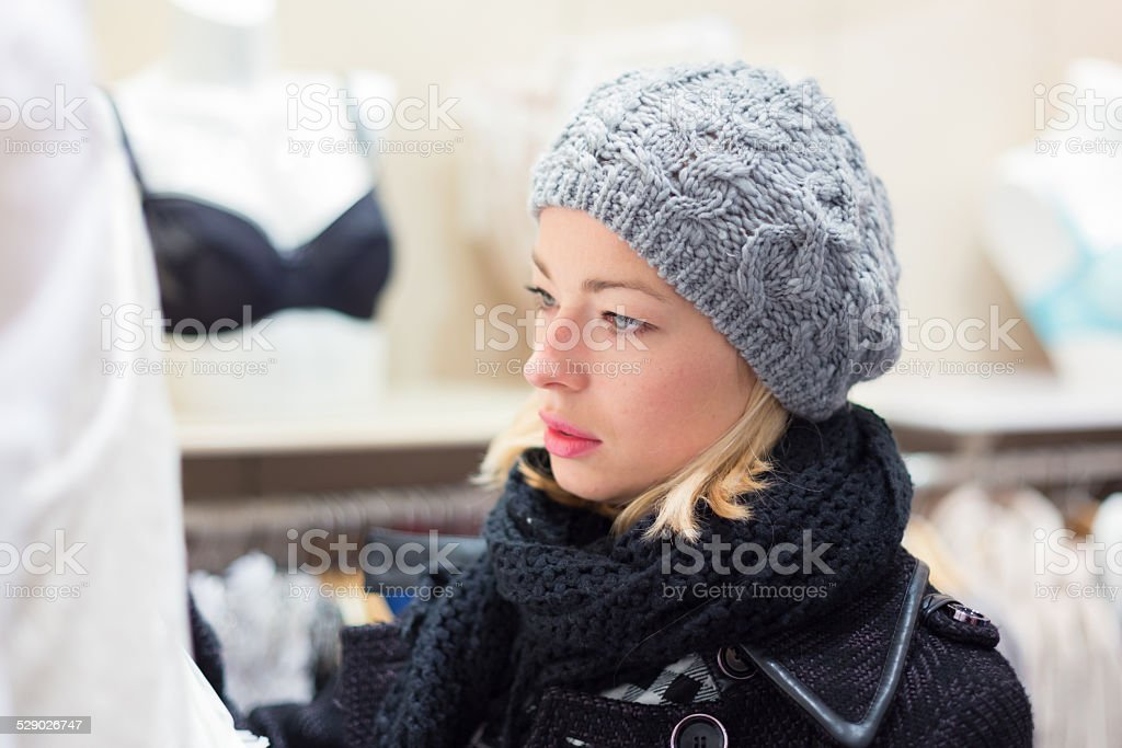 Beautiful lady shopping in lingerie store. stock photo
