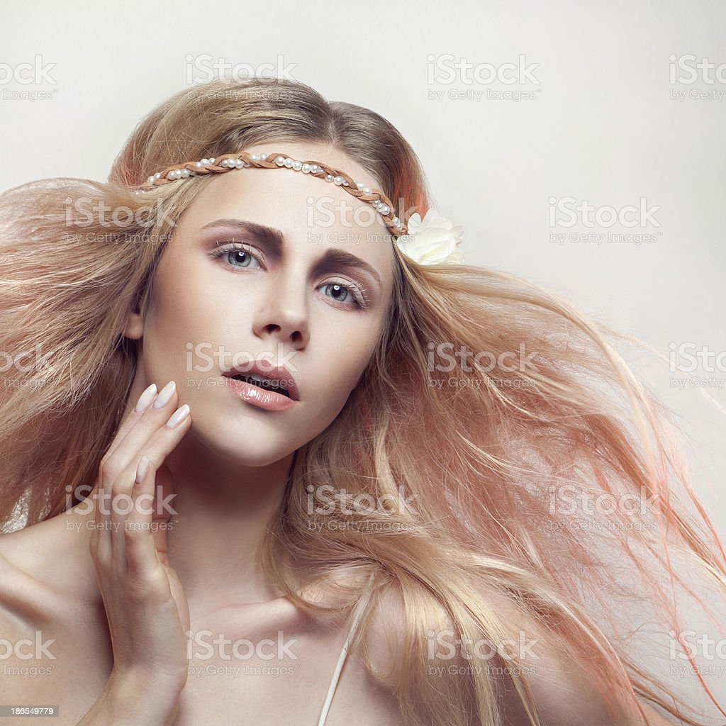 Beautiful lady with a white flower stock photo