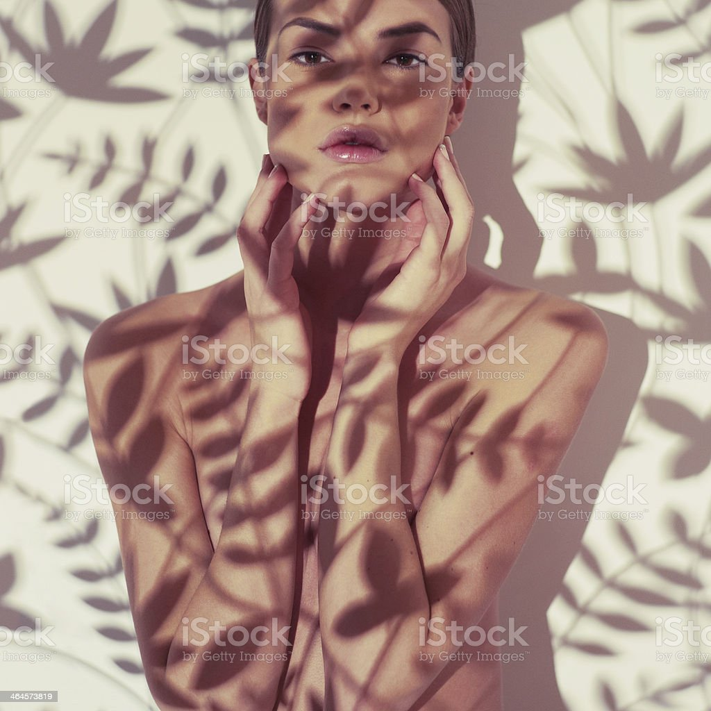 Beautiful lady with floral pattern on body stock photo