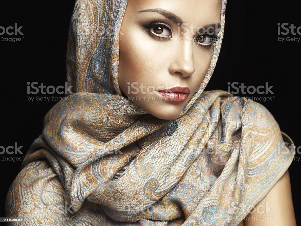 Beautiful lady wrapped in a shawl stock photo