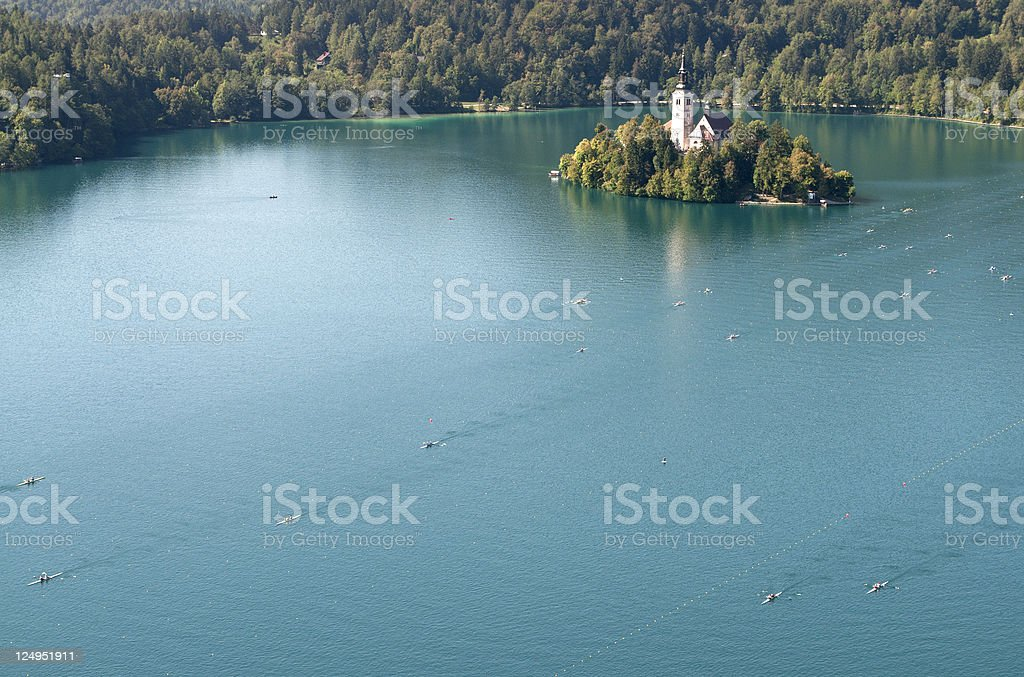 Beautiful Lake Bled with Rowing Teams royalty-free stock photo