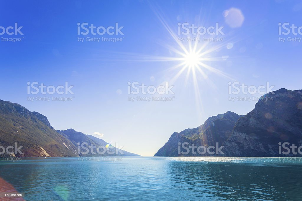 Beautiful Lake Garda and Sun, Italy stock photo
