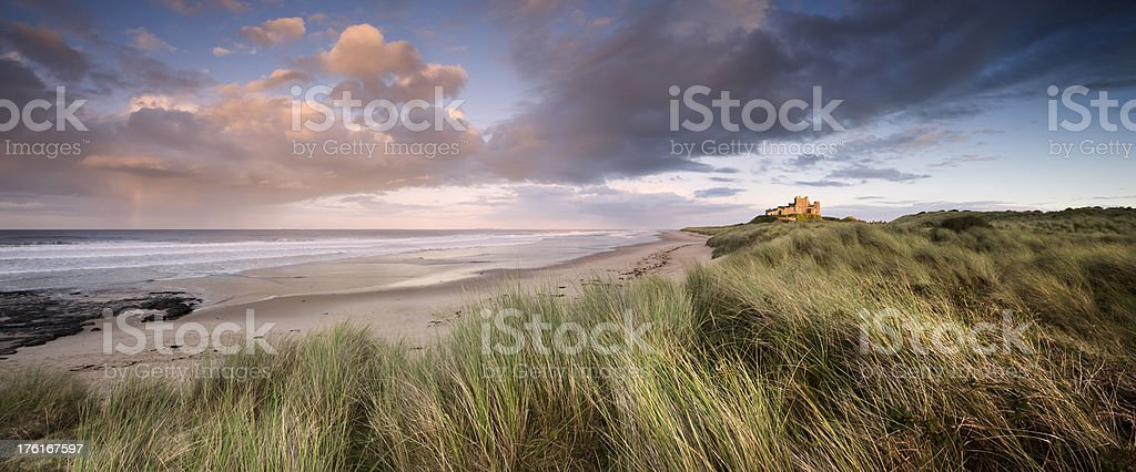 Beautiful landscape and clouds in Bamburgh Castle at sunset royalty-free stock photo