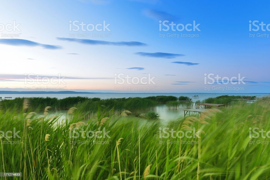 Beautiful landscape by the lake at sunset royalty-free stock photo