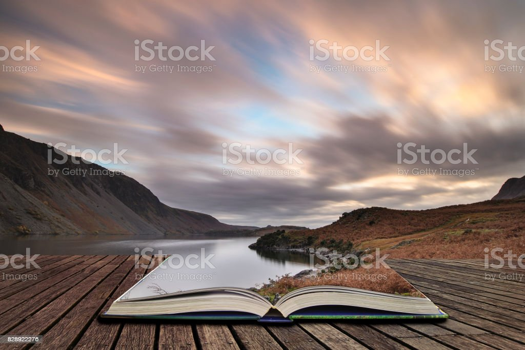 Beautiful landscape image of mountains around Wast Water in Lake District England in Autumn concept coming out of pages in open book stock photo