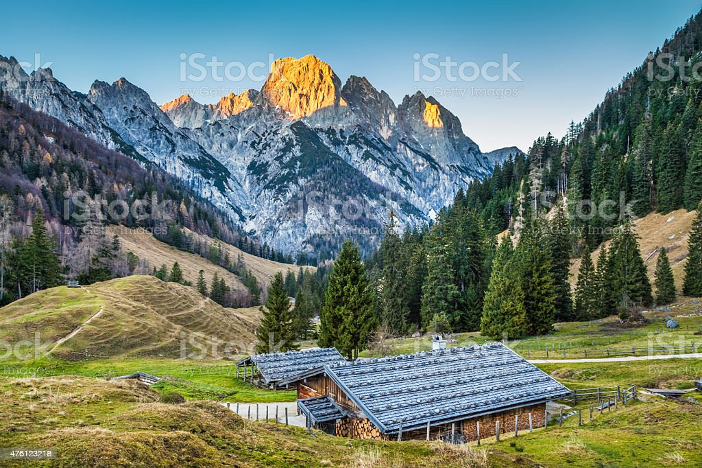 Beautiful landscape in the Alps with traditional mountain chalet stock photo