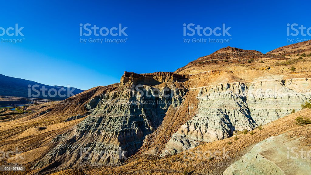 Beautiful landscape. Multi-colored rocks on the background of blue sky stock photo