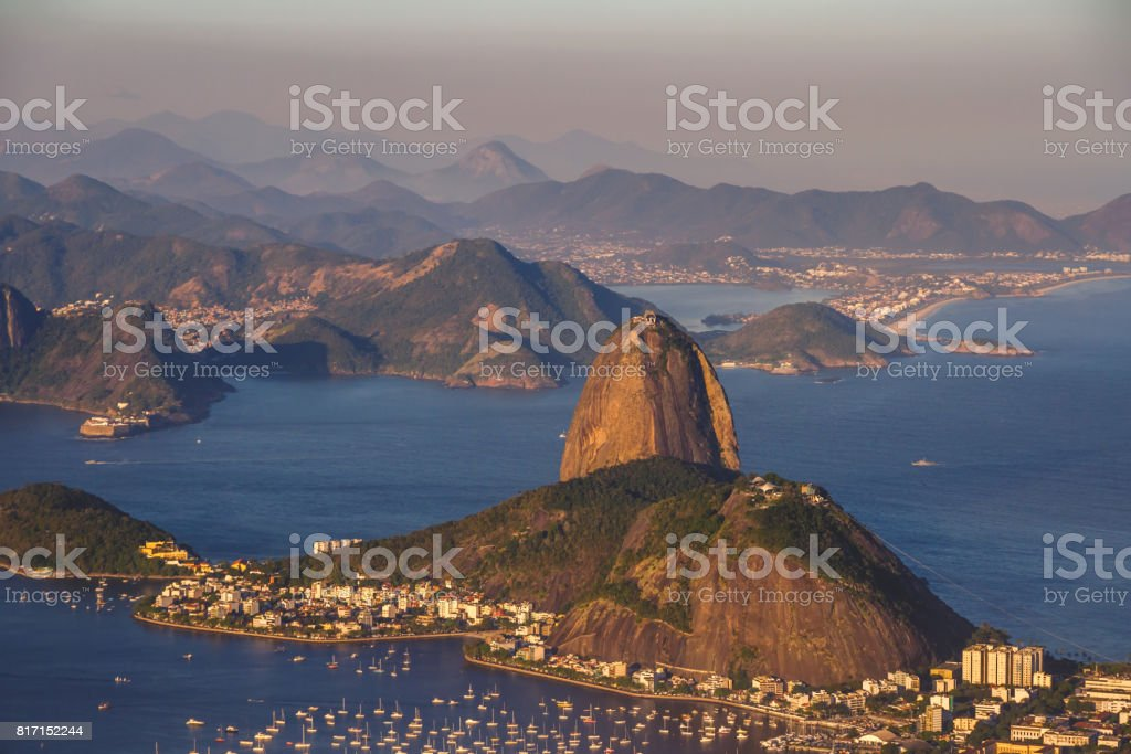 Beautiful landscape of the Sugarloaf mountain in the sunset. Yachts nearby, Guanabara bay, Urca district. Rio de Janeiro, Brazil. stock photo
