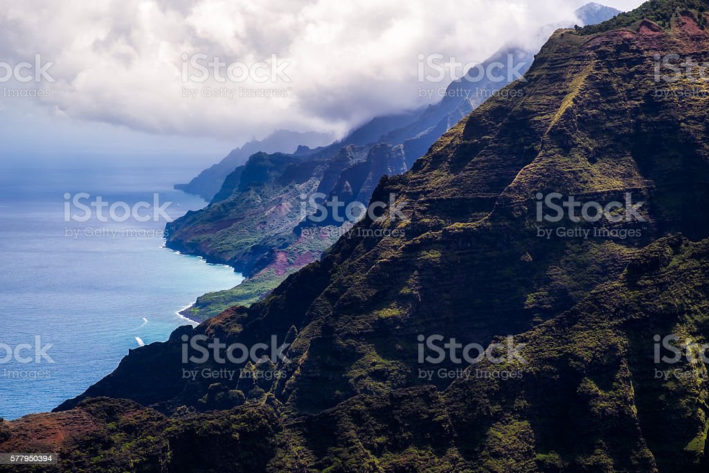Beautiful landscape view of Na Pali coastline in dramatic style, stock photo