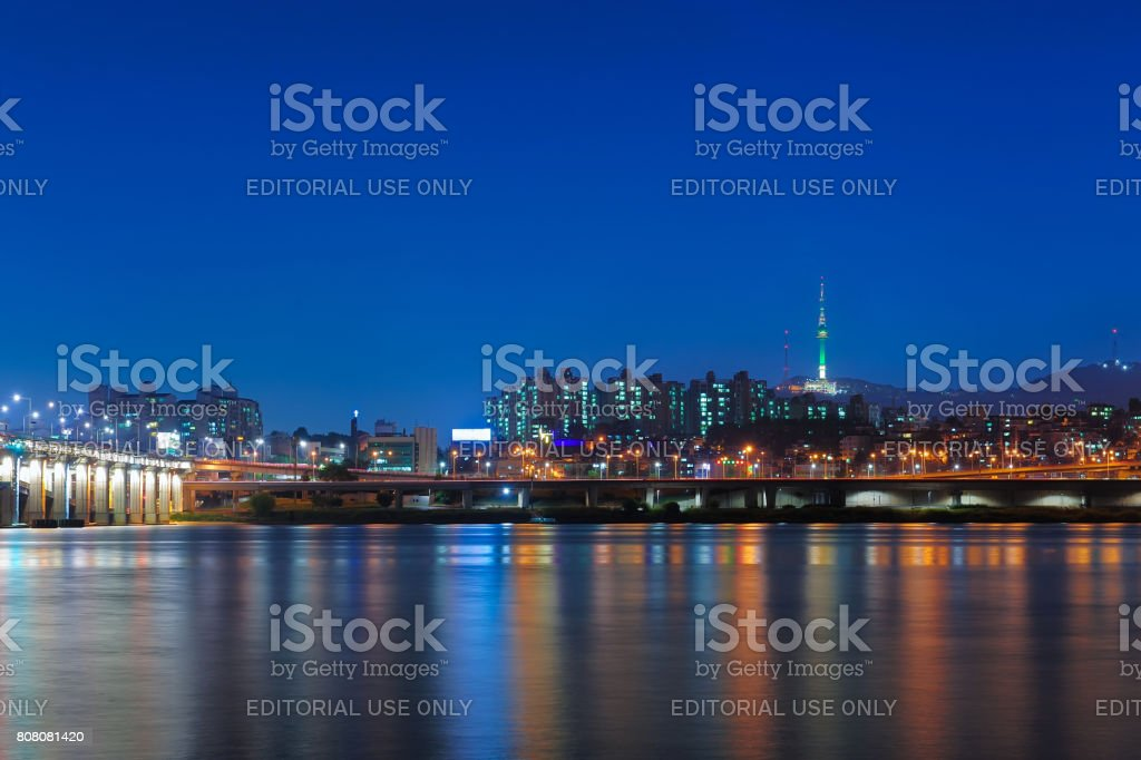 Beautiful landscape view of Namsan mountain with N seoul tower from han river and banpo bridge in twilight time at seoul, south korea stock photo