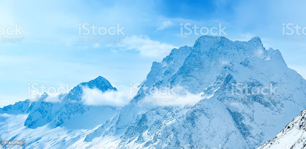 beautiful landscape winter snow covered of Dombaj mountain peaks stock photo