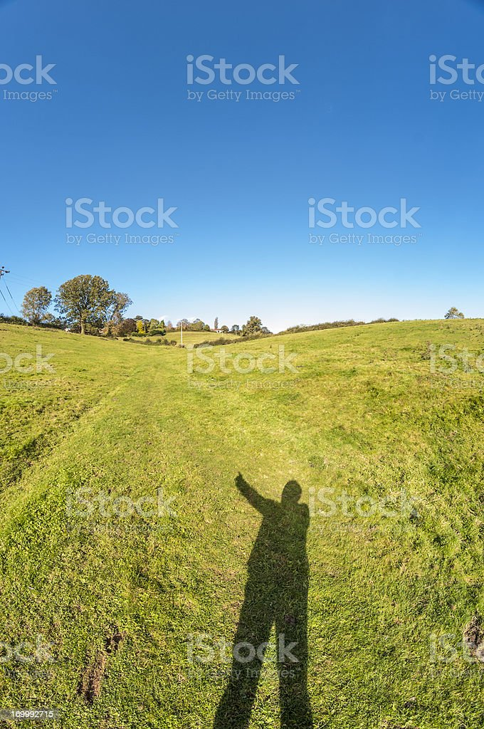Beautiful Landscape With A Shadow Figure Pointing Up royalty-free stock photo