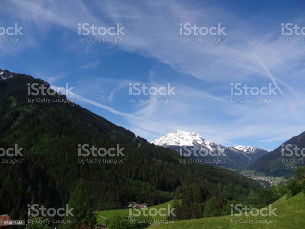 Beautiful landscape with blue sky on a path near Mayrhofen and the Zillertal Alps in Austria stock photo