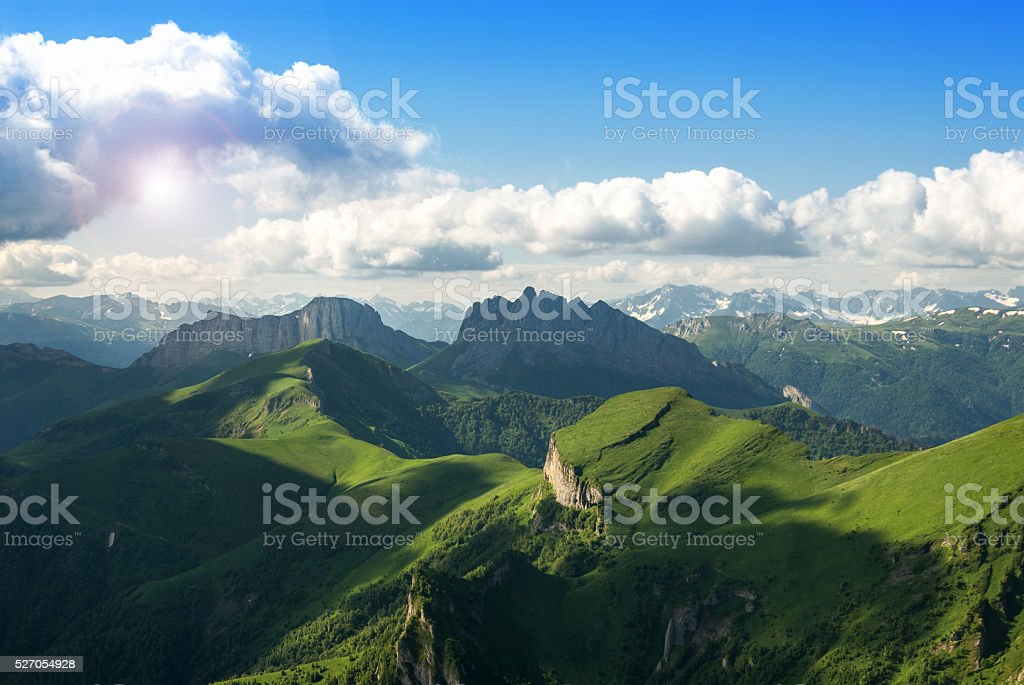 Beautiful landscape with mountains and green hills stock photo