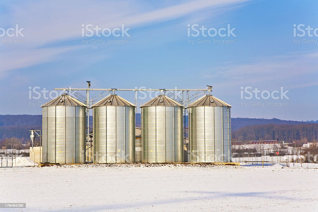 beautiful landscape with silo and snow white acre royalty-free stock photo
