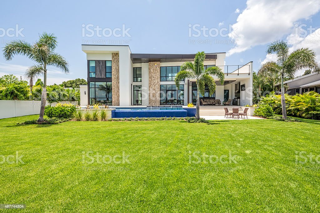 Beautiful Landscaped Modern Home with Swimming Pool and Sitting Area stock photo