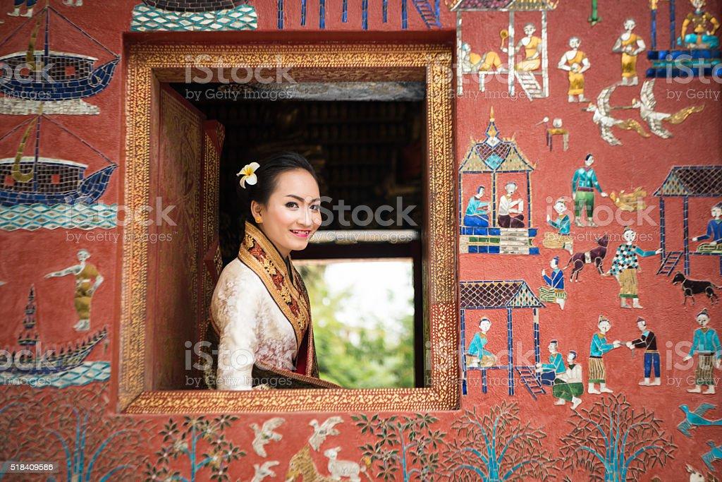 Beautiful Laos lady in traditional costume at Luang Prabang stock photo