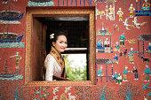 Beautiful Laos lady in traditional costume at Luang Prabang