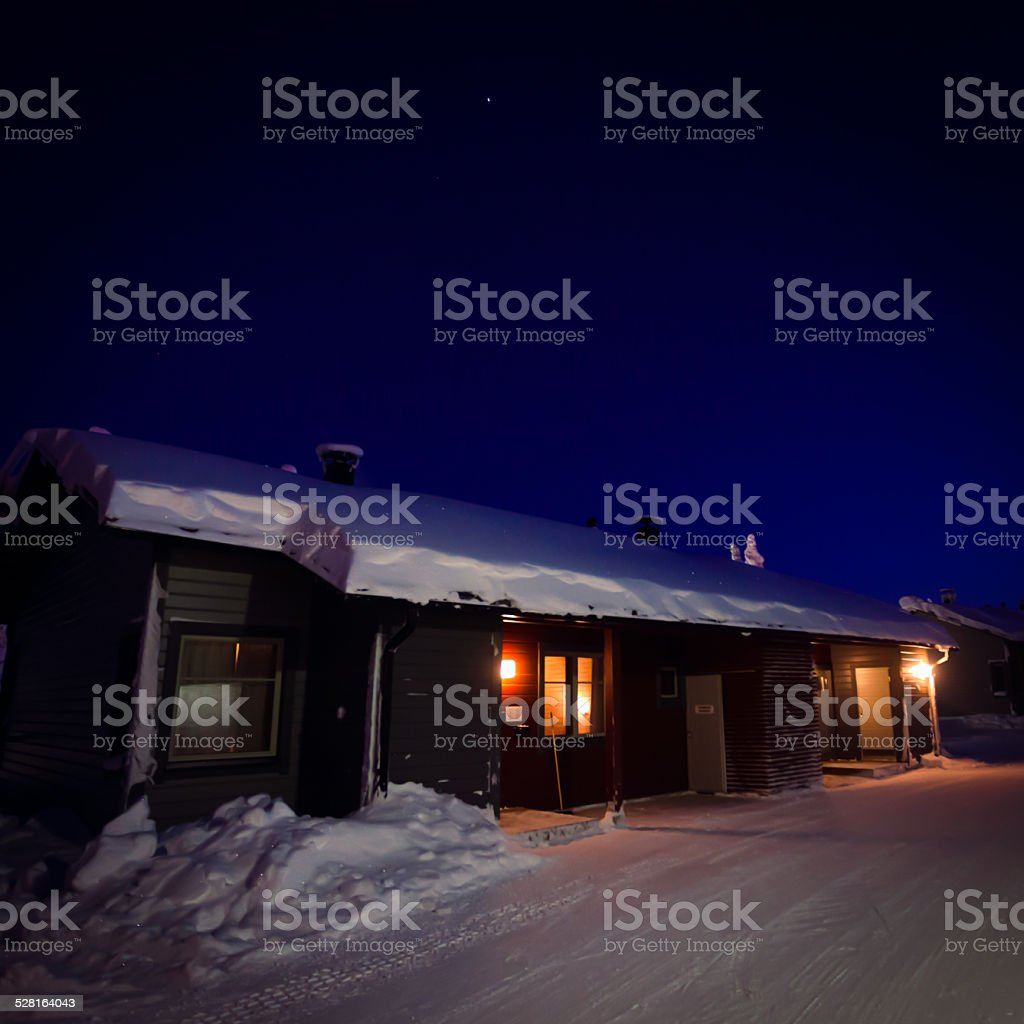 Beautiful lapland winter landscape with cottage cabin village in christmas stock photo
