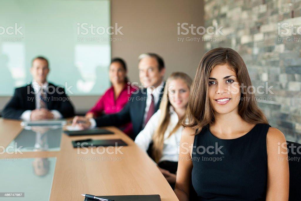 Beautiful latin business woman posing in meeting royalty-free stock photo
