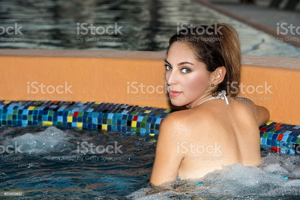 beautiful latina girl looking at you from whirlpool stock photo