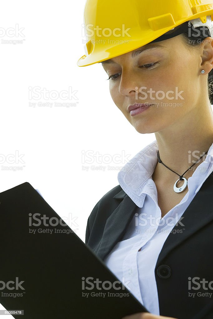 Beautiful Latina Hispanic Woman In Hard Hat With Clipboard royalty-free stock photo
