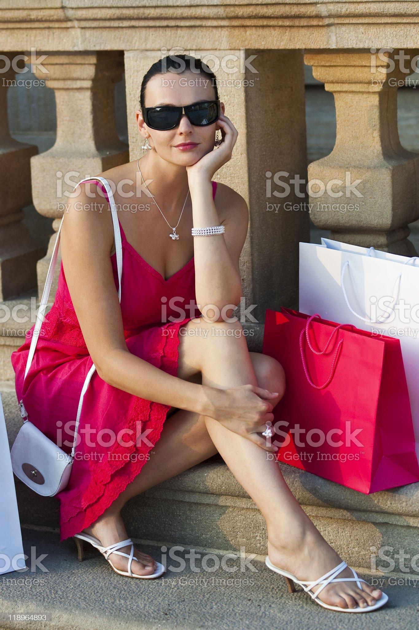 Beautiful Latina Hispanic Woman Sitting With Shopping Bags royalty-free stock photo