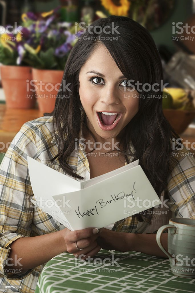 Beautiful Latina Woman with Birthday Card stock photo