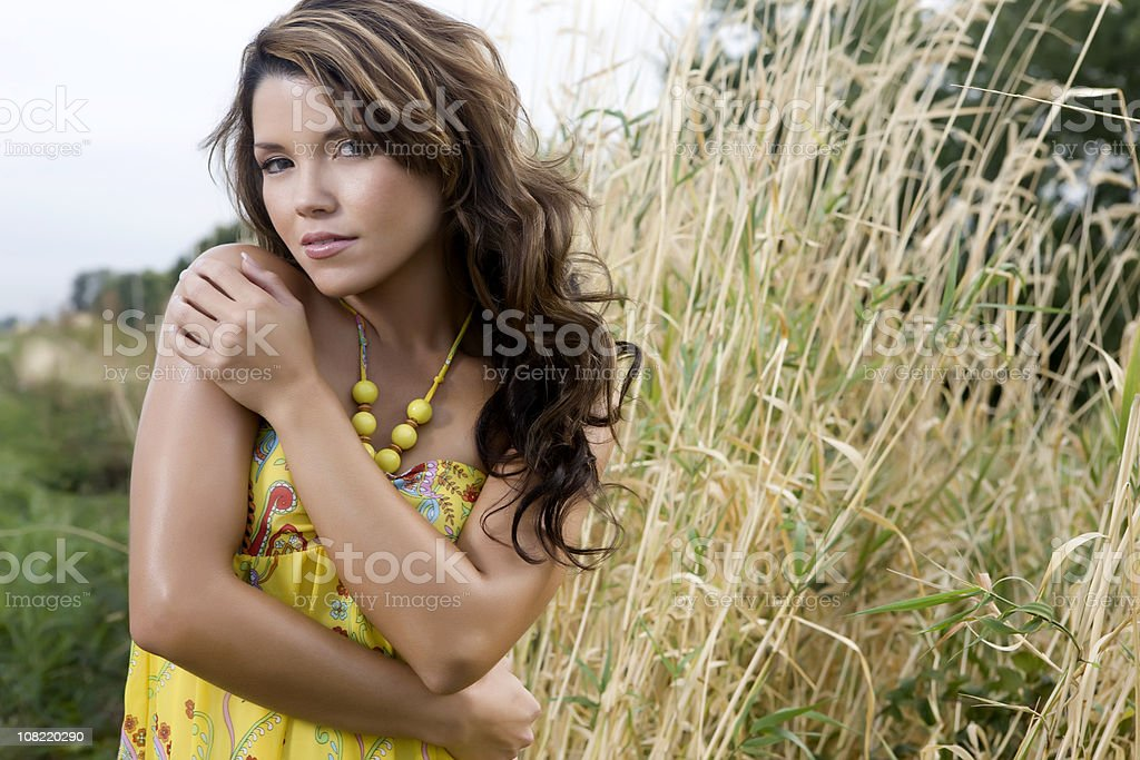 Beautiful Latina Young Woman in Summer Dress Outside, Copy Space stock photo